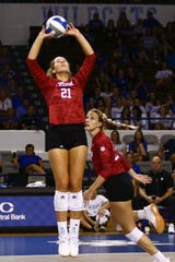 Freshman Emily Fitzner sets for a teammate in Indiana's win over Kentucky.