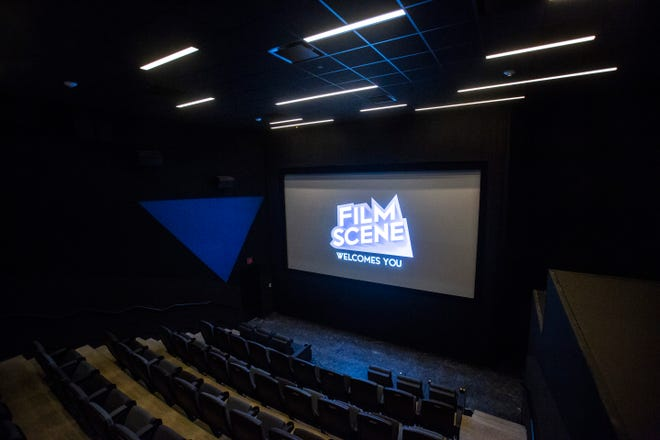A screen projection from FilmScene welcomes guests while construction nears completion, Tuesday, Sept. 17, 2019, at FilmScene in The Chauncey, along Gilbert Street in Iowa City, Iowa.