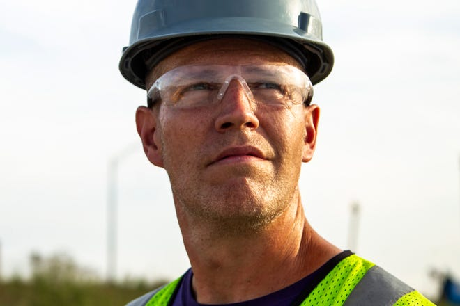 Aaron Poisel, a pipe fitter at an eastern Iowa company, poses for a photo Tuesday, Sept. 10, 2019, outside a construction site.