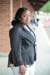 Sakenna Dear, a teacher at Clarksdale Collegiate in Clarksdale, Miss., waits for students to arrive on April 25, 2019. Her foster son, Ricky Taylor, also attends the public charter school.