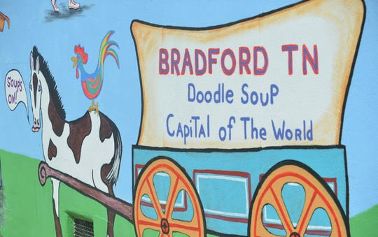 "A mural on East Main Street in Bradford, Tenn. features a horse pulling a wagon bearing the town's claim to fame: ""Doodle Soup Capital of the World,"" on Sept. 16, 2019."