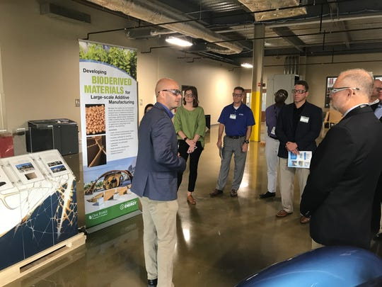 Vlastimil Kunc, group leader for polymer materials development at Oak Ridge National Laboratory's Manufacturing Demonstration Facility, describes the 3D printing process during a tour Sept. 17, 2019.