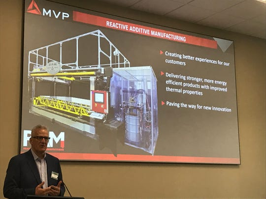 Magnum Venus Products President and CEO Bob Vanderhoff describes the new Reactive Additive Manufacturing 3D printer Sept. 17, 2019.