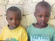 Betsy and Shawn Wright saw this picture of Wenkers and Gregory and decided to adopt them from Haiti