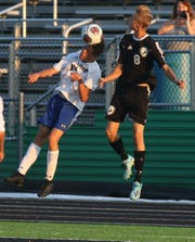 Ontario's Aiden Frankhouse heads the ball during the Warriors' 3-0 win over Clear Fork on Monday.