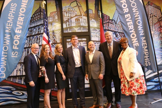 State and local economic development professionals celebrate the opening of Prospero Health's new operational headquarters in Downtown Memphis. From left: Ted Townsend, Gwyn Fisher, Jennifer Oswalt, Michael Scarbrough, Doug Wenners, Mayor Jim Strickland and Beverly Robertson.