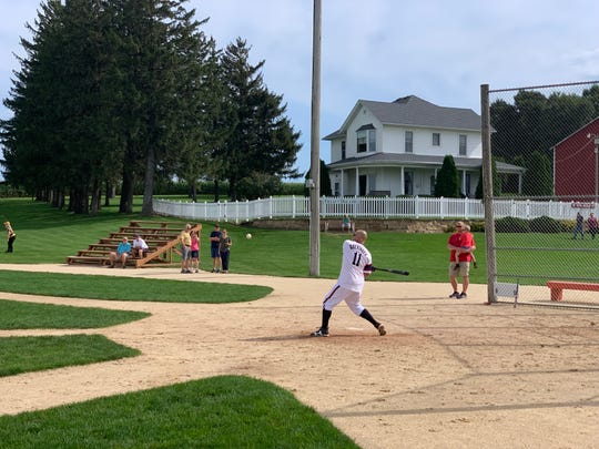 A baseball player gets ready to hit a ball at the Field of Dreams in northeast Iowa.