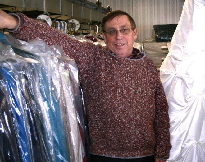 Dennis Valstad is rewarding everyone who attended his funeral with a check for about $1,872. He put the plan in his will but kept it a secret around Ripon where he lived. Valstad, who died in July, is shown here at the dry cleaning business he used to own.