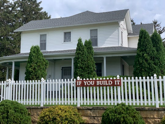 """A sign on 1906 farmhouse used in the 1989 movie """"Field of Dreams"""" reads """"If You Build It,"""" a key line from the film."""