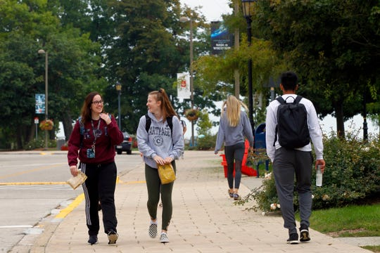 Students walk the campus at Carthage College on Tuesday.