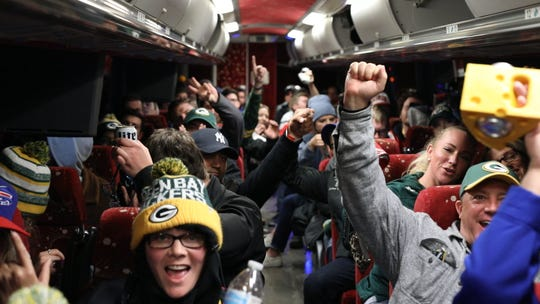 Packers fans celebrate on a shuttle bus to Lambeau Field from the Milwaukee Brat House. The bar is one of a handful in the city that have regular shuttles to Lambeau Field.