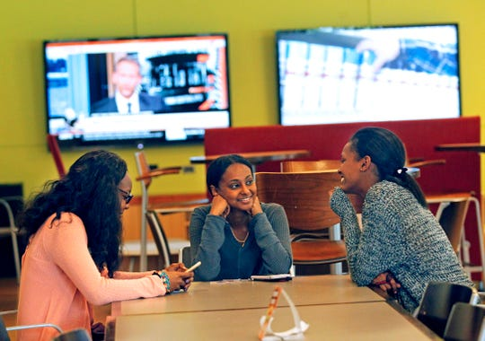 From left, Dorcas Salifu, 19, Rediet Mulatu, 18, and Tsion Tegicho, 16, take a break from class at the Campbell Student Union at Carthage College on Tuesday, Sept. 17, 2019, in Kenosha. The college is lowering its tuition by 30%.