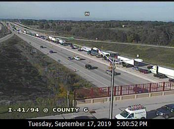 This freeway camera image shows northbound traffic slowing to a crawl on northbound I-94/41 at Highway G. The state Department of Transportation says the crash in Milwaukee County just north of 7 mile road has blocked the two right lanes of the freeway, backing up traffic for miles.