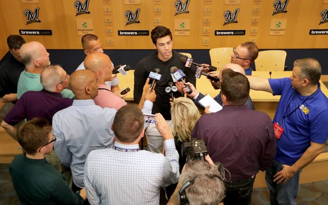 Christian Yelich speaks with reporters Monday at Miller Park, making his first public comments since suffering a broken kneecap last Tuesday.