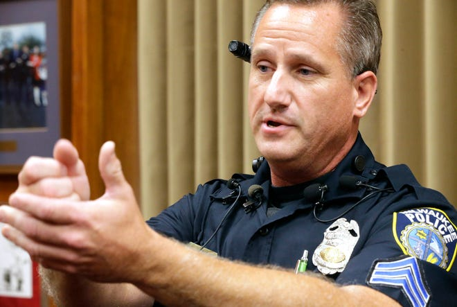Milwaukee police Sgt. Douglas Wiorek explains how the body camera attached with a clip near the ear is better than on the chest area, as it could be blocked if the officer is holding a firearm, in this file photo from 2015.