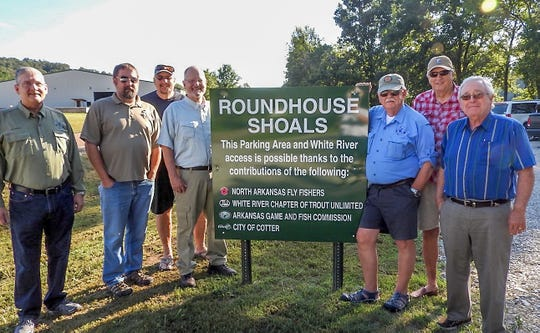 A combined effort from the North Arkansas Fly Fishers, the White River Chapter of Trout Unlimited, the Arkansas Game & Fish Commission and the City of Cotter has refurbished the Roundhouse Shoals Access point in Cotter. Pictured are: (from left) Mark Burgess, Tim Burnley, Bill Thorne, Cotter Mayor Mac Caradine, Mike Tipton, Wayne Buck and Tom Emerick.