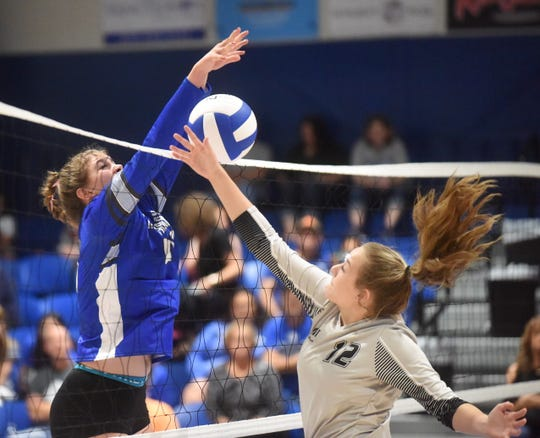 Cotter's Kate Cheek blocks against Marshall earlier this season. The Lady Warriors posted a three-set sweep at Green Forest on Monday night.