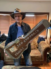 Led Zeppelin fan Jeff Curtis, right, with a guitar case belonging to Jimmy Page that he obtained backstage at a concert in 1972. Sept. 15, 2019.