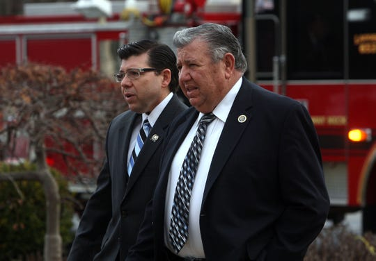 Parsippany, 01/13/12---Anthony Bucco Jr, l, and father Tony arrive at the funeral for Alex DeCroce. DeCroce, a state assemblyman for more than two decades, was buried following a funeral Mass Friday at St. Peter the Apostle Church attended by about 500 people, including Gov. Chris Christie and other prominent state politicians.