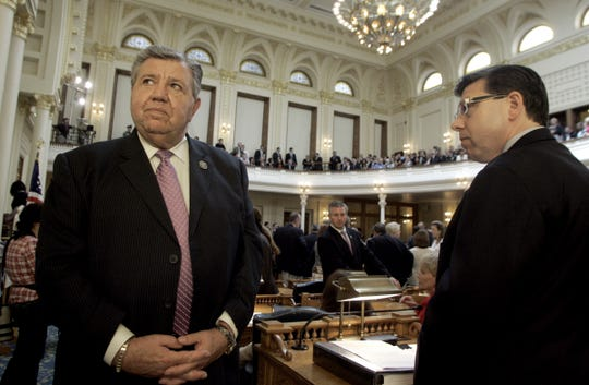 Senator Anthony R. Bucco (left, R-Morris) and his son Assemblyman Anthony M. Bucco (R-Morris) wait for the start of Governor Chris Christie's  address to a joint session of the Legislature gathered at the Statehouse in Trenton Thursday.  7/1/10