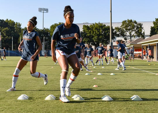 Auburn women's soccer player Kori Locksley warms up with teammates.