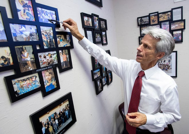 Montgomery mayoral candidate David Woods shows photos of his church mission trips displayed at his television station WCOV TV in Montgomery, Ala., on Tuesday September 17, 2019.