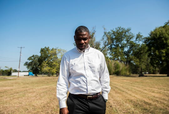Tyrone Jackson walks the land where his church once stood in the Riverside neighborhood in Montgomery, Ala., on Tuesday, Sept. 17, 2019. The city has announced plans to build a whitewater outdoor center in the riverside neighborhood.