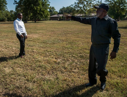Sonny Jackson, right, and his son Tyrone Jackson walk the land that their church once stood in the Riverside neighborhood in Montgomery, Ala., on Tuesday, Sept. 17, 2019. The city has announced plans to build a whitewater outdoor center in the riverside neighborhood.