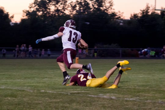 Wes-Del wide receiver Caeden McClaughry breaks a tackle against an Alexandria defender at Alexandria High School on Aug. 23, 2019.