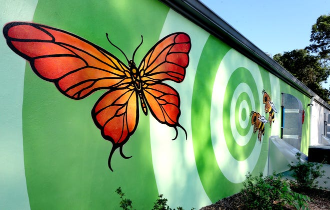The new mural going up by Ryan Frizzell and Meagan Armes on The Bug Man building on West Lokey Ave in Murfreesboro, on Tuesday Sept. 17, 2019.