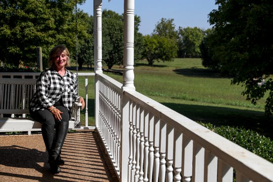 Rhonda Tucker sits on the front porch swing at the Tucker farm in Springfield, Tenn., on Monday, Sept. 16, 2019.