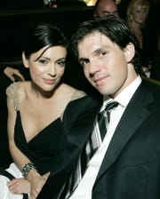 In this 2004 photo, actress Alyssa Milano, left, and pitcher Barry Zito are at the 15th Annual Associates for Breast and Prostate Cancer Studies Gala to benefit a research center in L.A.
