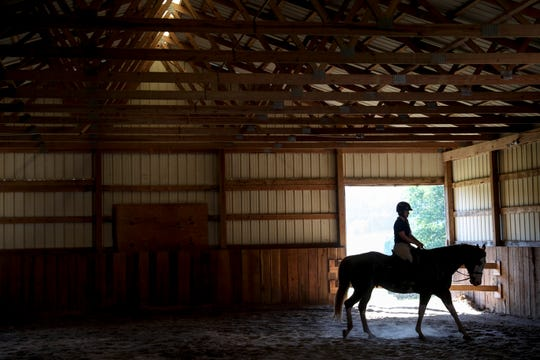 Courtney Alexander, the trainer hired by the Tuckers, takes Epic around in one of the main barns at the Tucker farm in Springfield, Tenn., on Monday, Sept. 16, 2019.