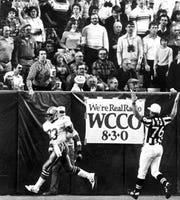 Cowboys running back Tony Dorsett drops the ball after a 99-yard touchdown run in the fourth quarter Jan. 4, 1983, against the Minnesota Vikings.
