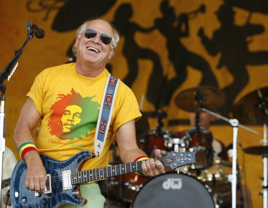 Jimmy Buffett performs during the 2006 New Orleans Jazz and Heritage Festival in New Orleans.