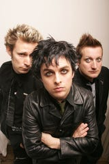 "Rock Band, Green Day (left to right) bass player Mike Dirnt, vocals and guitar Billie Joe Armstrong, and drummer Tre Cool, who are celebrating several grammy awards and a new album entitled ""American Idiot"", pose for a portrait in New York City on the eve of a European tour in 2015.  Photo by Todd Plitt, Contract"