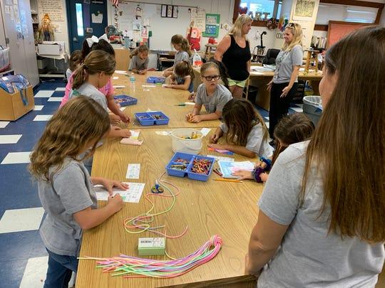 Troop 89 leader Melissa Levens leads the troop at their Sept. 12, 2019 meeting at Laurel Oak Elementary.