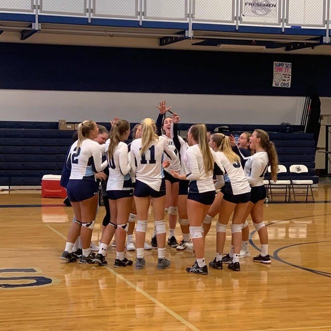 The Marco Island volleyball team celebrates its win at the Oasis tournament Saturday. The Manta Rays are off to a 12-1 start, already establishing the school record for victories in a season.