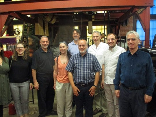 "Performers in the upcoming opera, ""The Silk City,"" with Paterson Museum Director Jack Destefano (second from left).  The artistic director of the opera, Francesco Santelli is in the front, center."