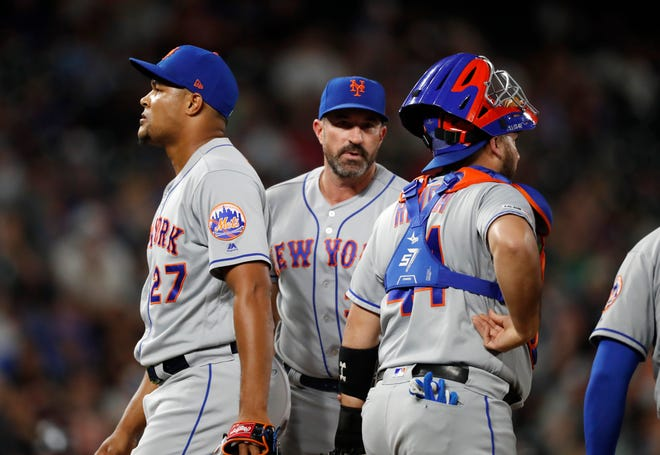 From left, New York Mets relief pitcher Jeurys Familia leaves the mound after he was pulled by manager Mickey Callaway as catcher Rene Rivera looks to the bullpen for relief pitcher Luis Avilan to face the Colorado Rockies in the seventh inning of a baseball game Monday, Sept. 16, 2019, in Denver. (AP Photo/David Zalubowski)