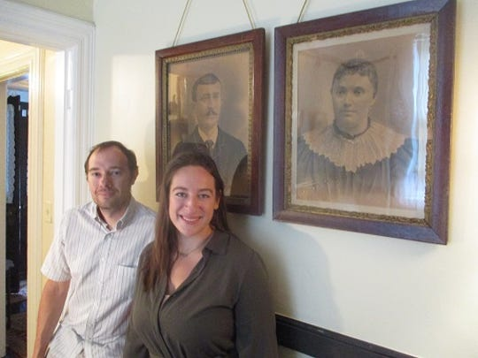 "Vocalists Daniel Kamalic and Rebecca Kidnie in front of portraits of Pietro and Maria Botto whom they will play in the upcoming opera ""The Silk City."""