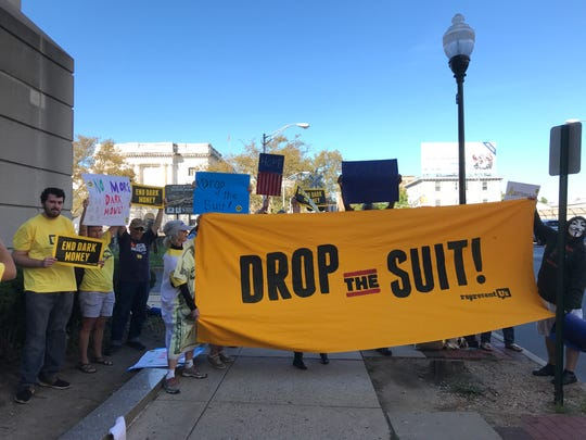 "Advocates from Represent New Jersey and Wolf PAC chanted and held signs outside the Trenton federal courthouse protesting a lawsuit challenging the state's ""dark money"" law."