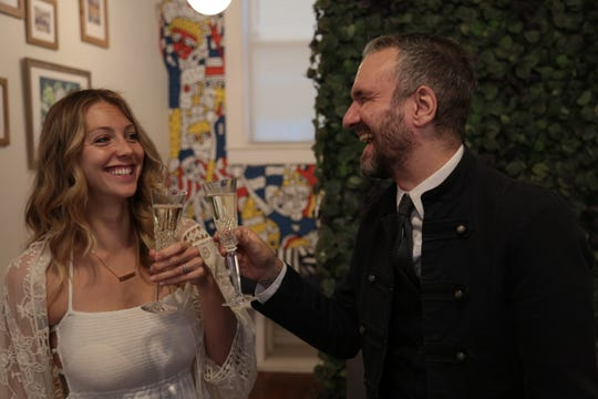 Jonathan Echeverry and his wife Lauren on their wedding day, which also happens to be the day Paper Plane opened.