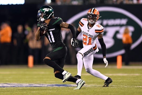 New York Jets wide receiver Robby Anderson (11) rushes with pressure from Cleveland Browns cornerback Denzel Ward (21) in the second half. The New York Jets lose to the Cleveland Browns, 23-3, in NFL Week 2 on Monday, Sept. 16, 2019, in East Rutherford.