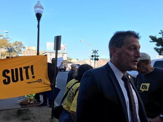"Assemblyman Andrew Zwicker, D-Middlesex, who sponsored New Jersey's ""dark money"" bill, speaks to reporters outside a Trenton courthouse where the law faces a challenge."