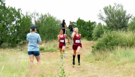 Sophomore Lady 'Cat Alexis Walker (at right) is in front during Saturday's Cobre cross country meet and junior teammate Kathleen Santistevan close behind. Walker and Santistevan finished 3rd and 4th respectively during the varsity race.