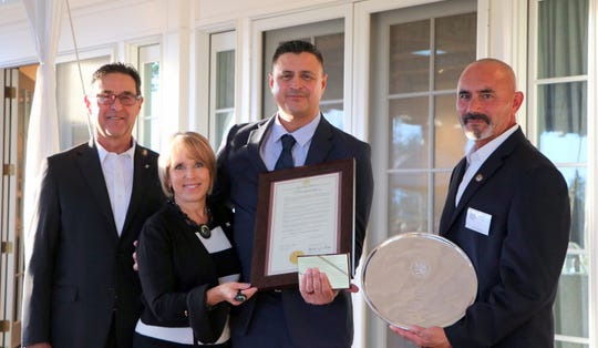 Pictured in Monday's award ceremony are, from left, Manny Cordova, Gov. Michelle Lujan Grisham, Deming Fire Chief Raul Mercado and Deming Mayor Benny Jasso.