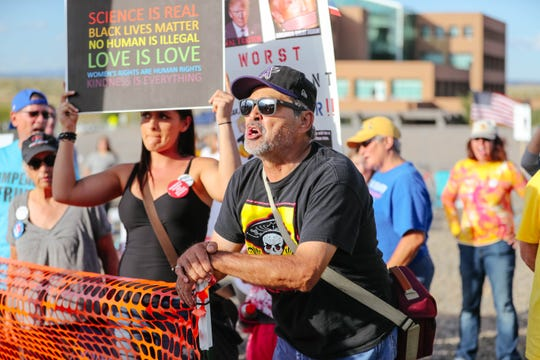 Hundreds gather to protest outside a rally for President Trump at the Santa Ana Star Center in Rio Rancho, New Mexico on Monday, Sept. 16, 2019.