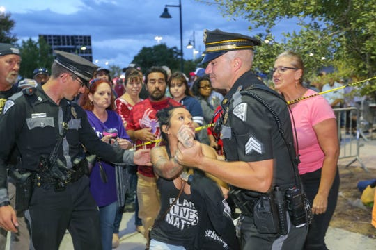 Jackie Montoya is detained by police after an altercation with a Trump supporter at a rally for President Trump at the Santa Ana Star Center in Rio Rancho, New Mexico on Monday, Sept. 16, 2019. The Las Cruces Sun-News and Farmington Daily Times won a USA TODAY Network quarterly award for their collaborative reporting on the Trump rally.