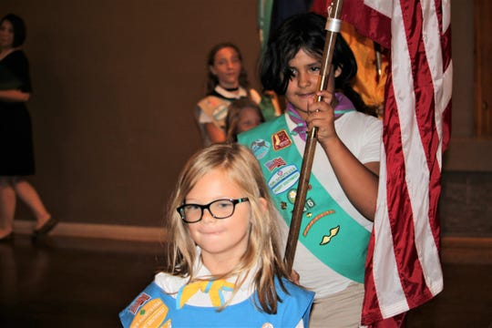 Members of the Girl Scouts of the Desert Southwest Color Guard, Troop 69546 of White Sands Missile Range, presents the American flag for the Pledge of Allegiance during the Women of Distinction luncheon at the New Mexico Farm & Ranch Heritage Museum on Tuesday, Sept. 27, 2019.